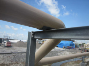 Steel Pipe rests on Steel Support with DynaGard pipe saddle in between helping with pipeline corrosion protection.